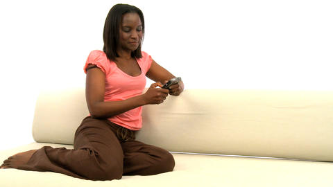 Attractive african american woman using a blackberry Stock Video Footage