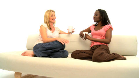 Attractive blonde and african american women talking on... Stock Video Footage