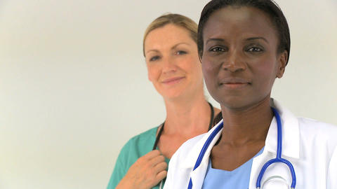 Multiethnic female medical team isolated on white, motion... Stock Video Footage