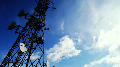 Communications tower time-lapse with clouds and blue sky Footage