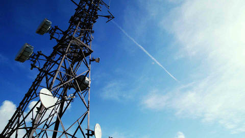 Communications tower time-lapse with clouds and blue sky Stock Video Footage