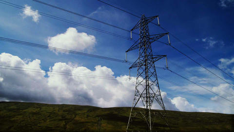 Electricity pylon time-lapse with clouds and blue sky Stock Video Footage