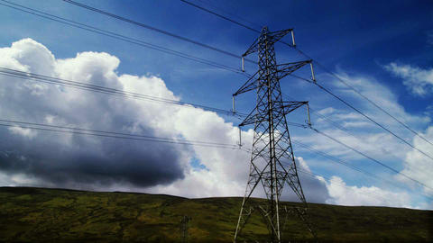 Electricity pylon time-lapse with clouds and blue sky Footage