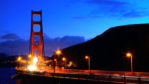 Timelapse of busy night traffic crossing the Golden Gate... Stock Video Footage
