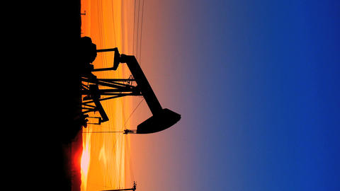 Vertical oil donkeys or pump jacks in perpetual motion at... Stock Video Footage