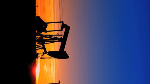 Vertical oil donkeys or pump jacks in perpetual motion at... Stock Video Footage