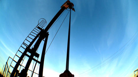 Fish-eye of oil donkeys or pump jacks in perpetual motion Footage