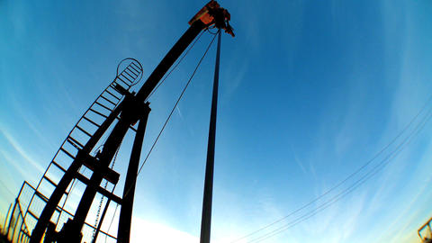 Fish-eye of oil donkeys or pump jacks in perpetual motion Stock Video Footage