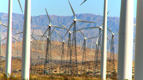 Cluster of wind turbines producing clean & renewable energy Stock Video Footage
