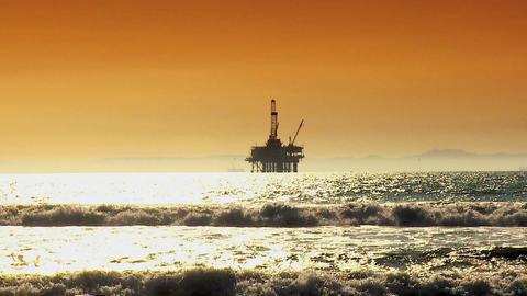 Oil platform at sea at sunset Footage