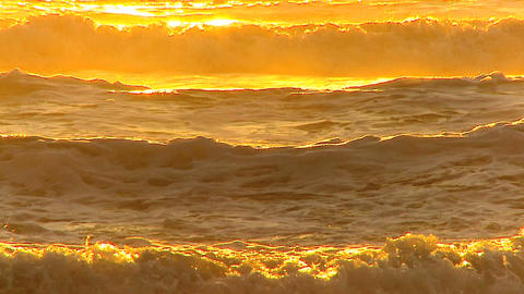 Surfing waves at sunset Stock Video Footage