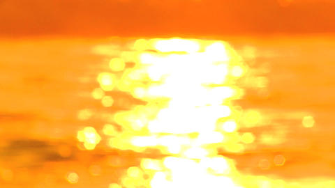 Out of focus sunshine on surfing waves Stock Video Footage