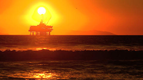 Oil platform at sea at sunset Footage
