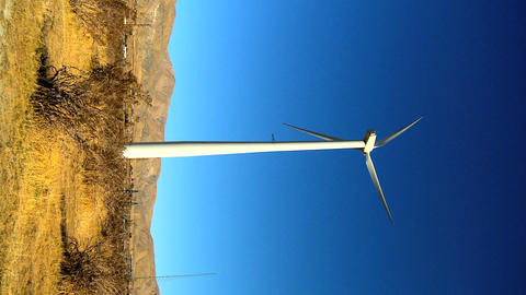 Vertical cluster of wind turbines producing clean &... Stock Video Footage