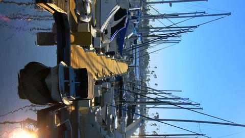 Vertical boats moored at a marina Stock Video Footage