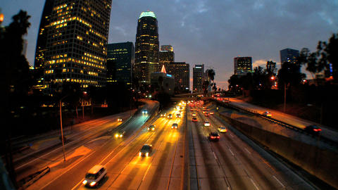 Traffic in downtown LA at night Stock Video Footage