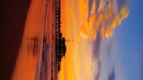 Vertical sunset on a Pacific coast beach outside Los Angeles Footage