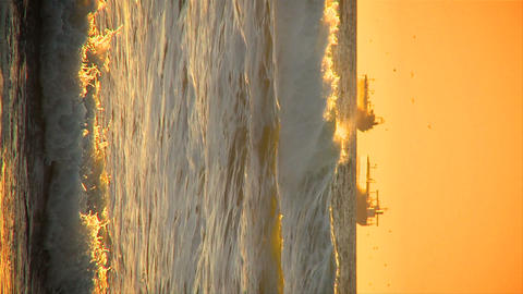 Vertical sunset over oil tankers at sea Stock Video Footage