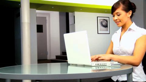 Young western oriental businesswoman working with laptop... Stock Video Footage