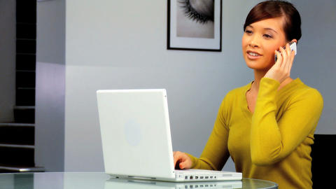 Young western oriental businesswoman using a laptop &... Stock Video Footage