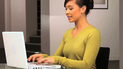 Young western oriental businesswoman sees success on her... Stock Video Footage