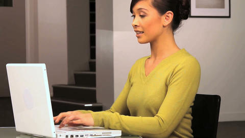 Young western oriental businesswoman sees success on her laptop computer Footage