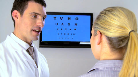 Ophthalmic optician working with patient Stock Video Footage