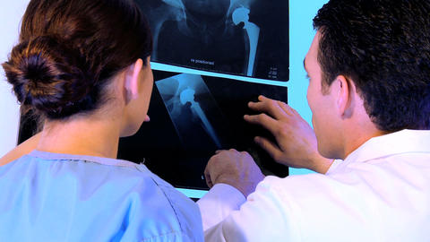 Western oriental & caucasian healthcare staff using x-ray charts Footage