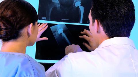 Western oriental & caucasian healthcare staff using x-ray... Stock Video Footage