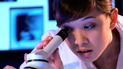 Western oriental & caucasian healthcare staff using... Stock Video Footage