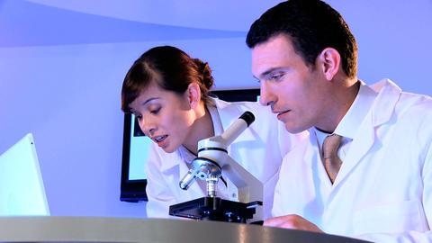 Western oriental & male caucasian healthcare staff using... Stock Video Footage