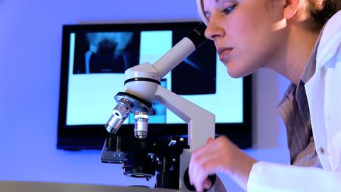 Young female healthcare staff working with laboratory... Stock Video Footage