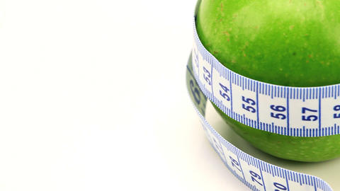 Studio close-up of fresh fruit & exercise aid for healthy... Stock Video Footage