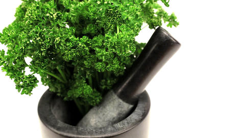 Studio close-up of fresh vegetables with pestle & mortar Stock Video Footage
