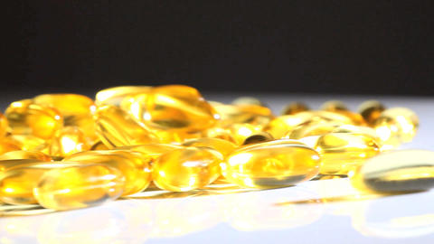 Studio close-up of vitamin capsulesfor healthy living Footage
