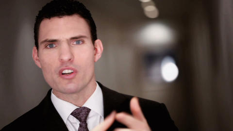 Ambitious businessman expressing his frustration at a... Stock Video Footage