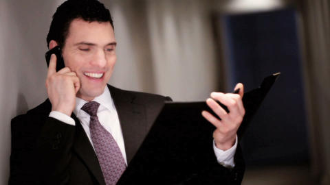 Ambitious businessman talking plans on his mobile phone Stock Video Footage