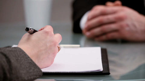 Hands only shot of young people in a business interview Stock Video Footage