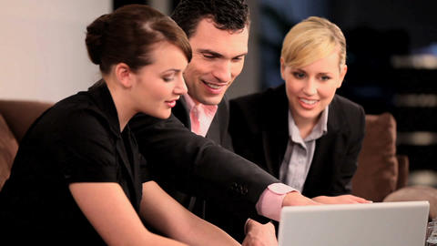 Young successful business colleagues working in advertising Stock Video Footage