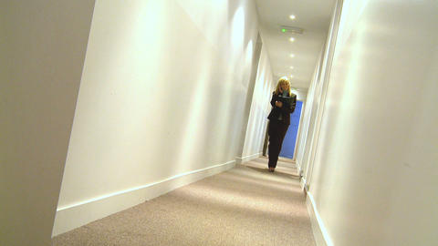 Young businesswoman using a mobile phone on way to team... Stock Video Footage