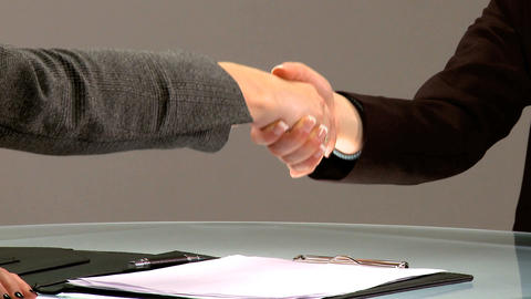 Young people shaking hands at the end of a business interview Footage