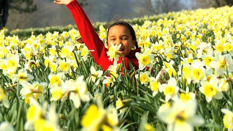 Girl Waving in Flower Field Footage