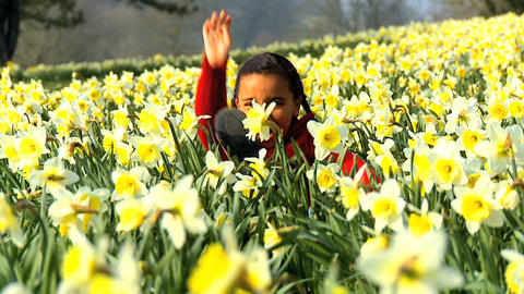 Girl Waving in Flower Field Stock Video Footage