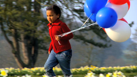 Running with Balloons Stock Video Footage