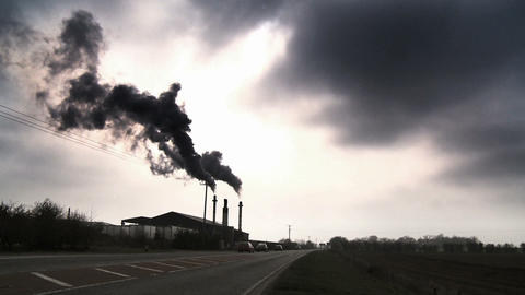Black smoke from a furnace being pumped into the atmosphere Footage