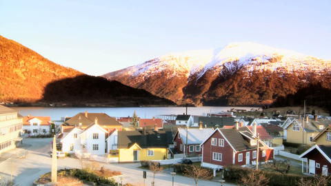 Time-lapse sunset over a Norwegian town beside a fjord Stock Video Footage