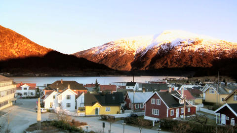 Time-lapse sunset over a Norwegian town beside a fjord Footage