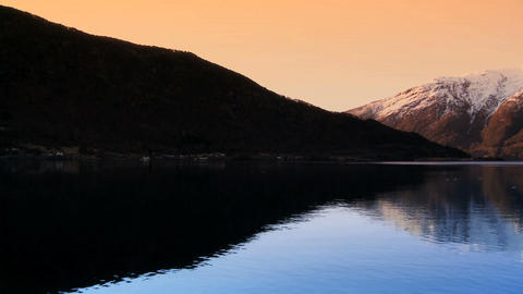 Sunrise over the crystal waters of a glacial fjord Footage