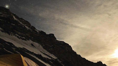 Aconcagua Time lapse Night: Stars dancing in the sky with tent Footage