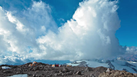 Aconcagua Time lapse - racing clouds at camp with climbers Stock Video Footage